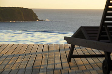 Sunlounger at the pool of Hotel Restaurant Le Rayon Vert in the evening light, Deshaies, Caribbean, America