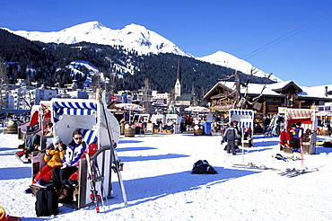 People at AprÈs Ski in beach chairs, Bolgen Plaza, Davos, Grisons, Switzerland, Europe