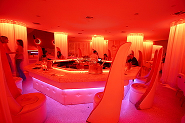 People in coloured light at Pearl Club, South Beach, Miami, Florida, USA, America