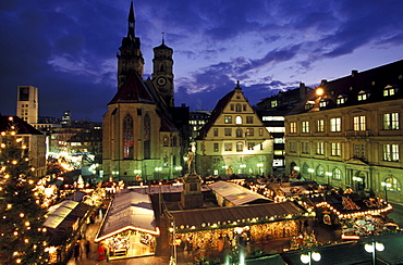 Christmas market on the Square Karlsplatz with church Stiftskirche and Schiller monument, Stuttgart, Germany