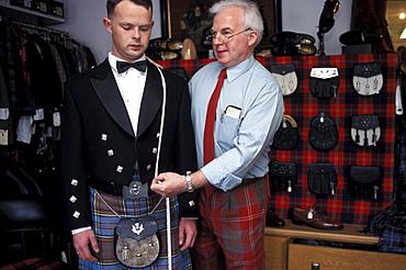 Kiltmaker Ian Chisholm taking measurements, Inverness, Scotland, Great Britain, Europe