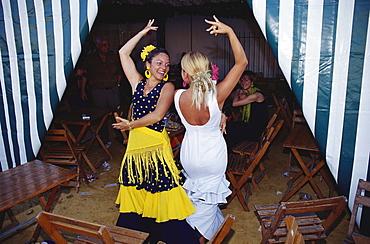 Women dancing at Feria del Vino Fino, Puerto de Santa Maria, Cadiz, Andalusia, Spain, Europe