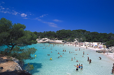 People swimming in the sea at Cala Turqueta, Minorca, Spain