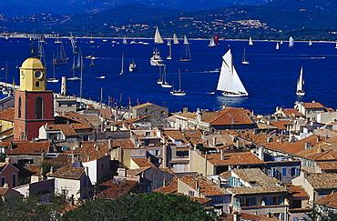 Sunlit roofs and sailing boats at Golfe de St.Tropez, St. Tropez, Cote d¥Azur, Provence, France, Europe