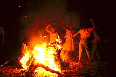 Young pilgrims dancing Sevillanas beside a campfire at night, RomerÃŒa al RocÃŒo, El RocÃŒo, pilgrimage, Andalusia, Spain