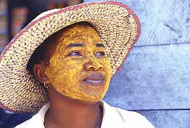 Vezo woman with painted face, face mask, Morondava, Madagascar