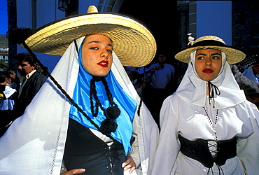 Two women in traditional clothes at the festival of the almond flower, Folklore music, Canary Islands, Spain