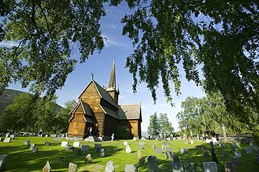 Stave church with gravestones, Stavkirka Lom, Oppland, Norway