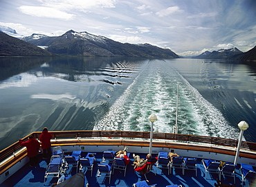 People sunbathing on a stern, Beagle Channel, South Chile, South America