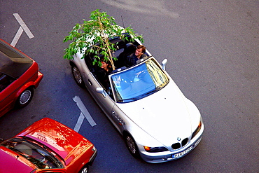 High angle view at a couple in a cabrio, Berlin, Germany, Europe