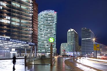Potsdamer Platz at night from left to right, Renzo Piano Tower, Hans Kollhoff Tower, Bahn Tower, Beisheim Center, Delbrueck Tower, Potsdamer Platz, Berlin, Germany, Europe