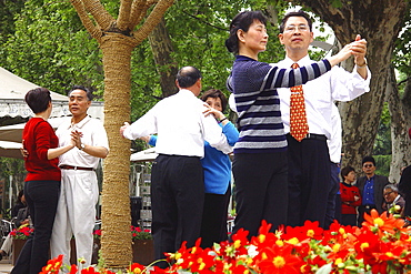 People dancing on sunday morning in a park, Shanghai, China, Asia