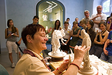 Porzellan Manufaktur Meissen, demonstrations workshop, workplace of the porcelain embosser, Embosser Karmen Friedrich at work, Meissen, Saxony, Germany, Europe