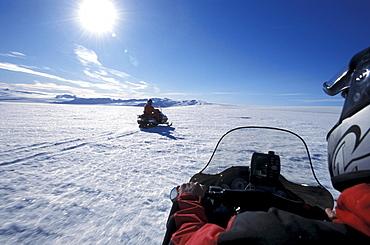 Snowmobiles on Brokarjoekull, a tongue of Vatnajoekull, Iceland