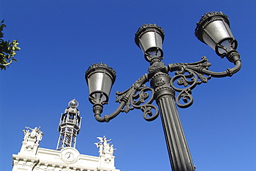 Street lamp and historical building under blue sky, Valencia, Spain, Europe