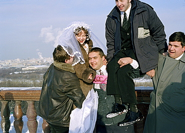 Friends making a joke with bride, Marriage, Sparrow Hills, Moscow, Russia