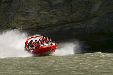 People in a Jetboat on Shotover River, Queenstown, Central Otago, South Island, New Zealand, Oceania