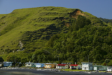 Holiday homes on the waterfront of Coromandel Peninsula, North Island, New Zealand, Oceania