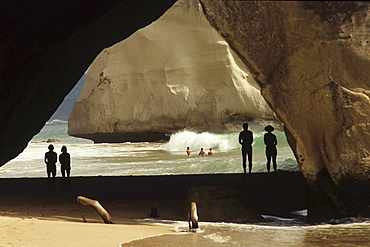 People on the beach in Cathedral Cave at Coromandel Peninsula, North Island, New Zealand, Oceania