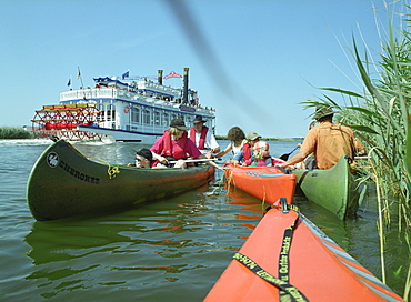 Canoes and shuffle boat on Prerowstrom, Fischland-Darss-Zingst, Mecklenburg-Western Pomerania, Germany