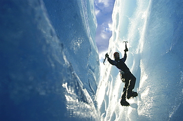 Person ice climbing at Briksdal Glacier, Norway