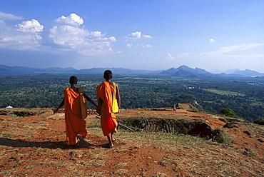 Two Monks on Sigiriya Rock, Lion's rock, an ancient rock fortress, Sigiriya, Sri Lanka