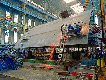 Welding steel plates, dry dock, Queen Mary 2, Saint-Nazaire, France