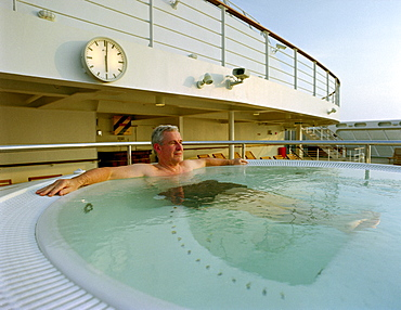 Mature man relaxing in a whirlpool, Cruise ship Queen Mary 2
