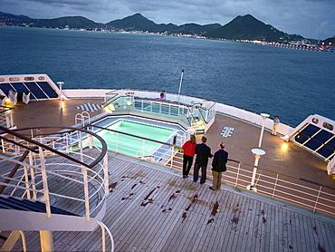 People on the quarterdeck looking towards the coast, Queen Mary 2, St. Maarten, Caribbean