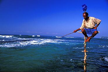 Stilt fisherman with fishing rod, Sri Lanka, Asia