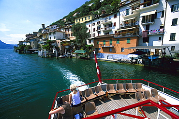 Gandria, People on excursion boat leaving Gandria, Lake of Lugano, Tessin, Switzerland