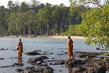 Two Indian women bathing in the water, Chiriya Tapu beach, South Andaman, Andaman Islands, India