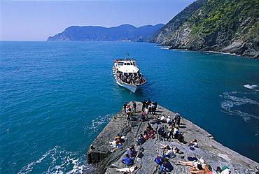 Excursion boat and people on the quai in the sunlight, Vernazza, Cinque Terre, Liguria, Italy, Europe