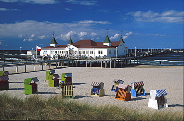 Beach chairs at a sandy beach with the sea bridge, Ahlbeck, Usedom, Mecklenburg-Vorpommern, Germany