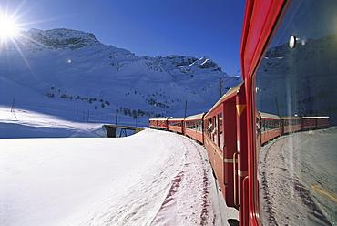 Rhaetische Bahn, railway in winter landscape, Engadin, Switzerland, Europe