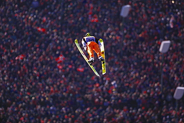 Ski jumper and spectators at the olympic games