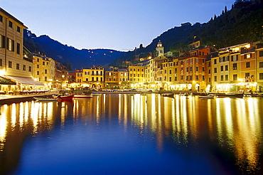 Illuminated restaurants at harbour in the evening, Portofino, Liguria, Italy, Europe