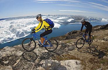 A couple on a mountainbike tour, Ilulissat, Greenland