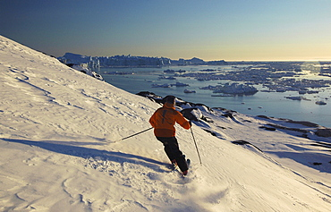 Person skiing down a slope, Ilulissat, Greenland