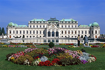 Flower beds in front of Belvedere castle under blue sky, Vienna, Austria, Europe