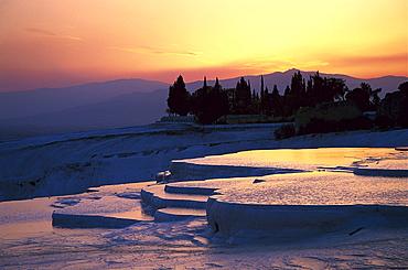 Sunset over the limestone sinter terraces, Pamukkale, Denizli, Turkey