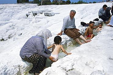 Turkish family at the limestone sinter terraces, Pamukkale, Denizli, Turkey