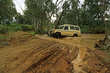 Four-wheel drive river crossing on the way to Mount Dare and the start of the Simpson Desert Crossing, Quensland, Australia