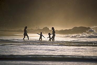 Sandy beach near Black Rock, Women with children, north coast of Tobago, West Indies, Caribbean