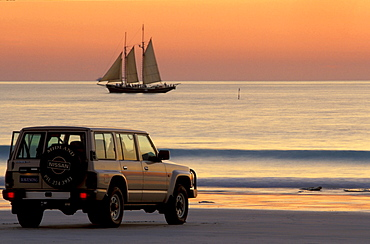 One car and sailingship in the evening light, sunset, Cable Beach, Broome, Western Australia, Australia