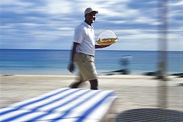 Waiter on beach, Hotel Oberoi, Mauritius