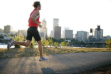 Runner running along the river shore, Portland, Relay Race from Mount Hood to the coast, Hood to Coast, Oregon, USA