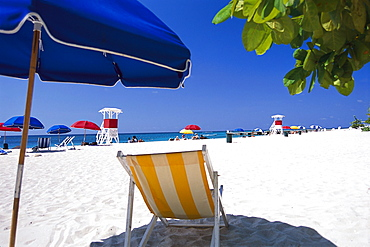 Deck chair standing at the beach in the sunlight, Doctors Cave, Montego Bay, Jamaica, Caribbean