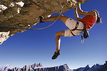 Alpine climber, free climbing, Dolomites, Italy
