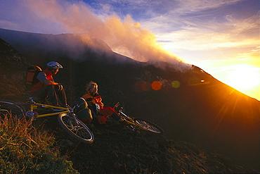 Mountain bikers on Vulcano island at sunset, Aeolian Islands, Sicily, Italy, Europe